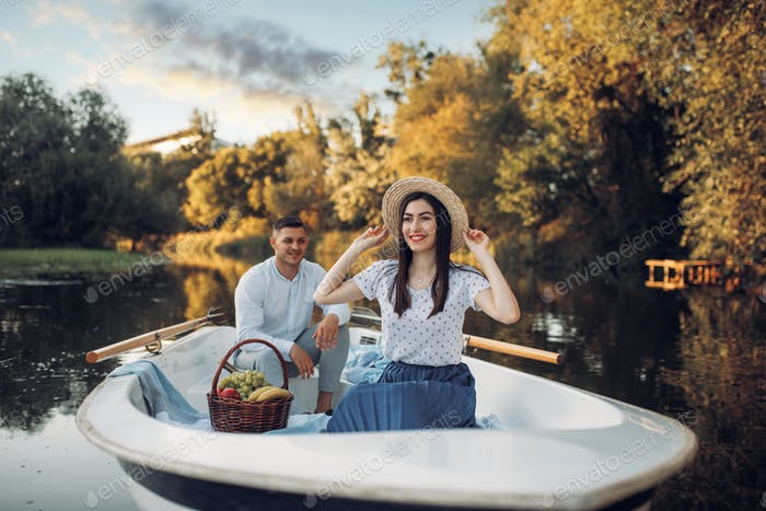 Love couple with fruit basket in boat