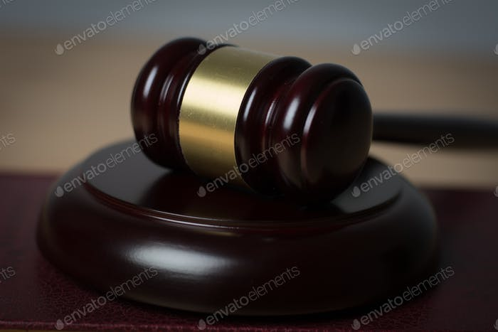 Close up of judge hummer on wooden background.