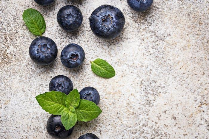 Fresh blueberries on light background