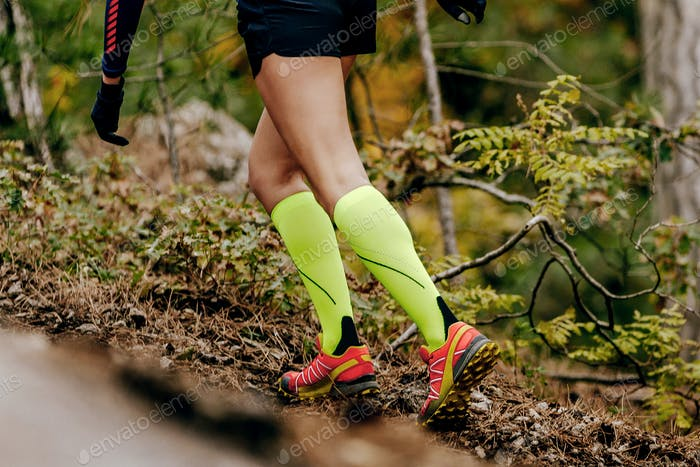 female runner in yellow compression socks