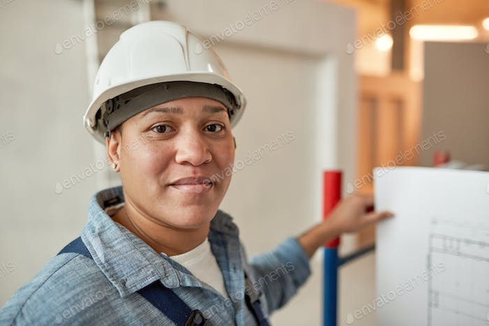 Female Worker Looking at Camera on Site