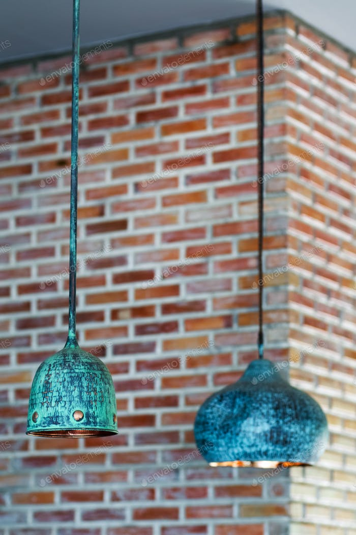 Decorative vintage candelier on brick wall backgroung