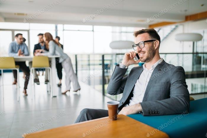 Inspired businesman sitting at coffee-break