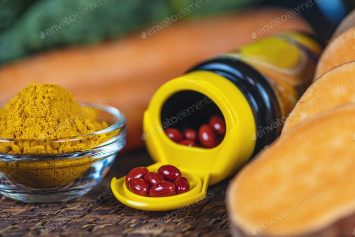 Beta Carotene Supplement Pills and Vegetables