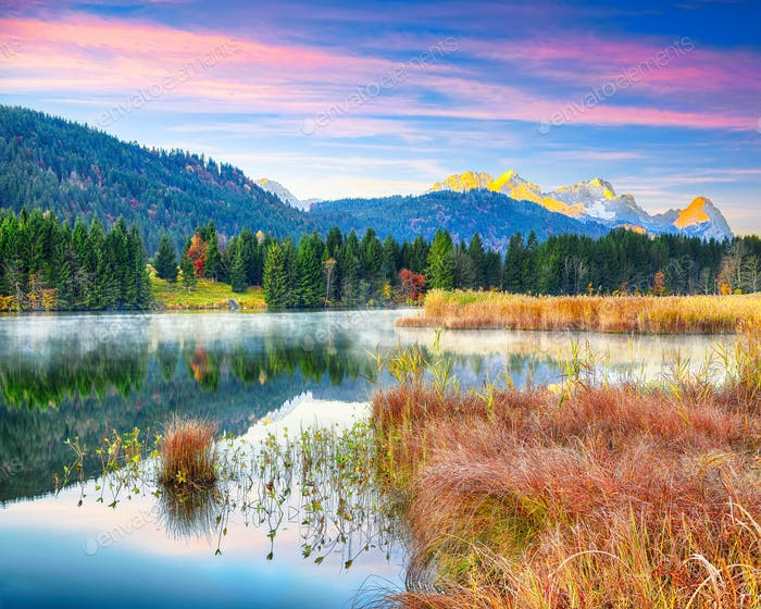 Awesome view of Wagenbruchsee (Geroldsee) lake with Zugspitze mountain range on background.