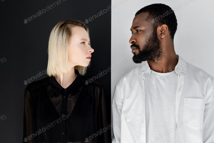 Side View of Multicultural Couple Looking at Each Other
