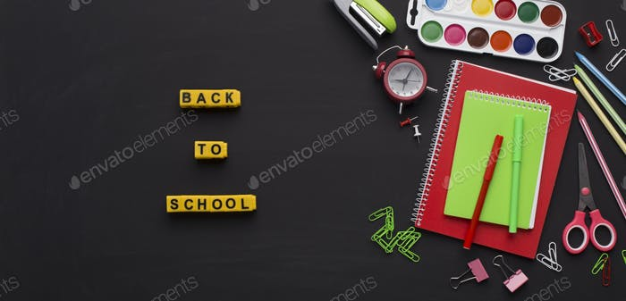 Back to school yellow text with office supplies on chalk board