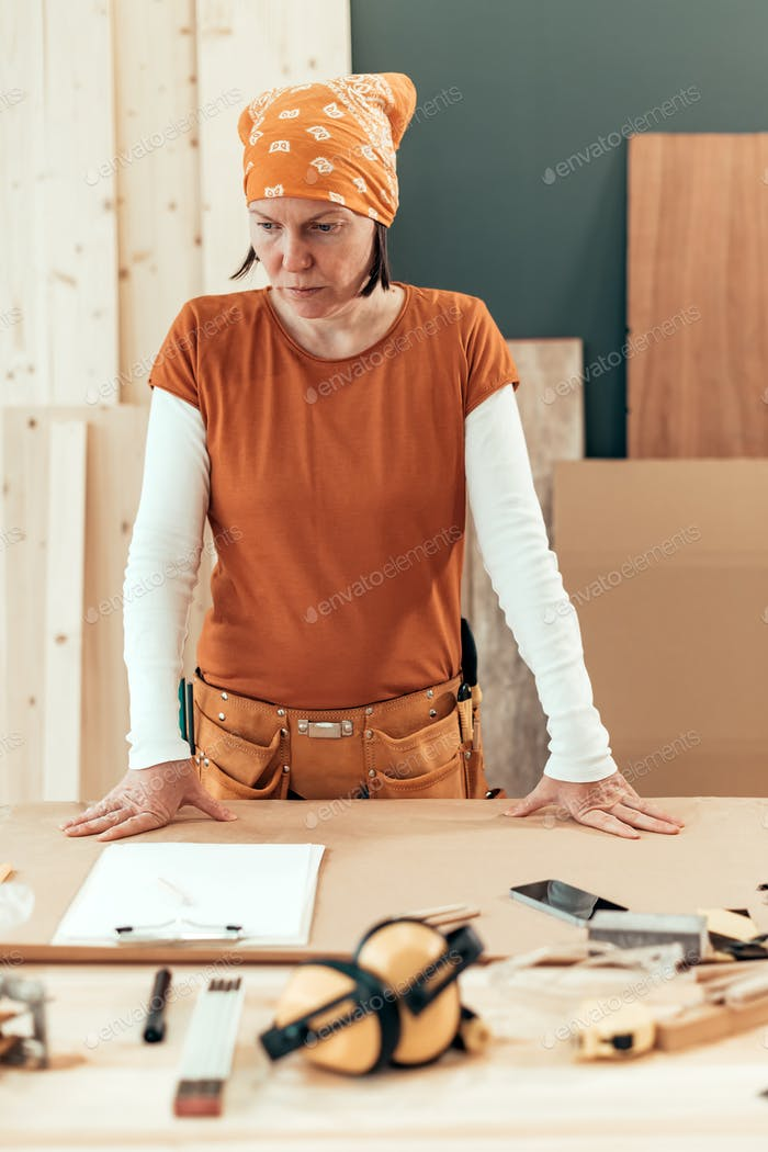 Self employed female carpenter planning DIY project
