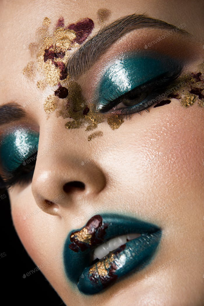Young woman with fantasy bright make up