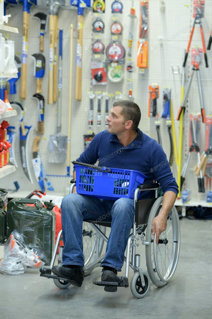 Handicapped man shopping with basket on his lap