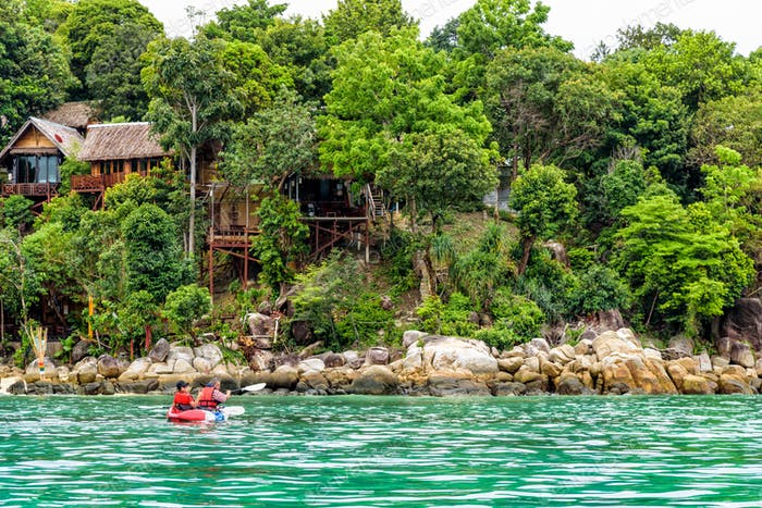 Father and daughter travel by kayak at Ko Lipe, Thailand