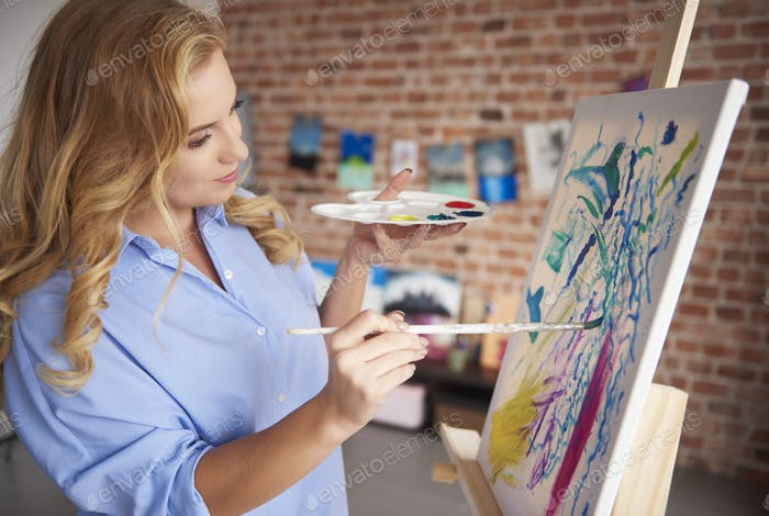 Focused painter and her painting
