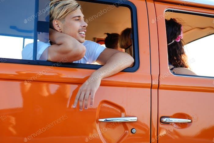 Hippie friends in a van on a road trip