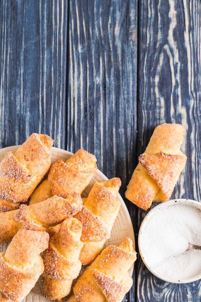 homemade cottage cheese mini croissants on a blue wooden background