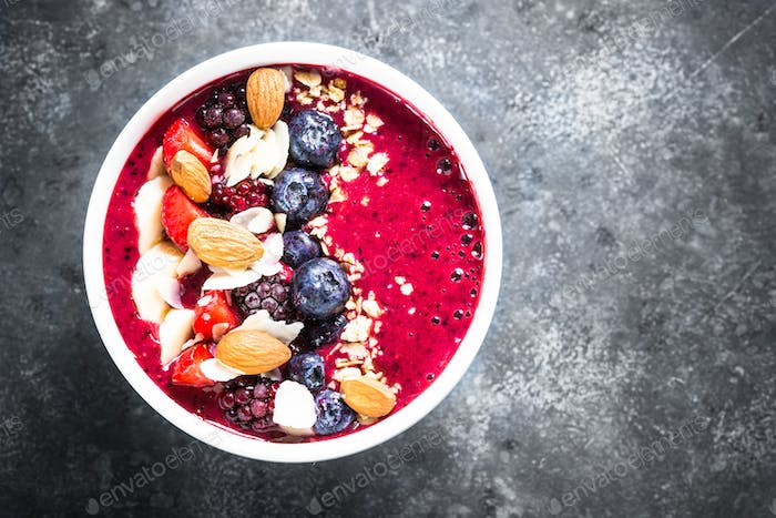 Smoothie bowl from fresh berries, nuts and granola