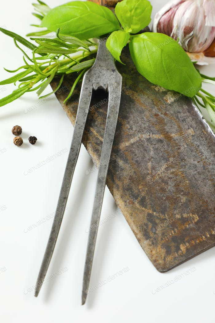 Old meat cleaver and carving fork