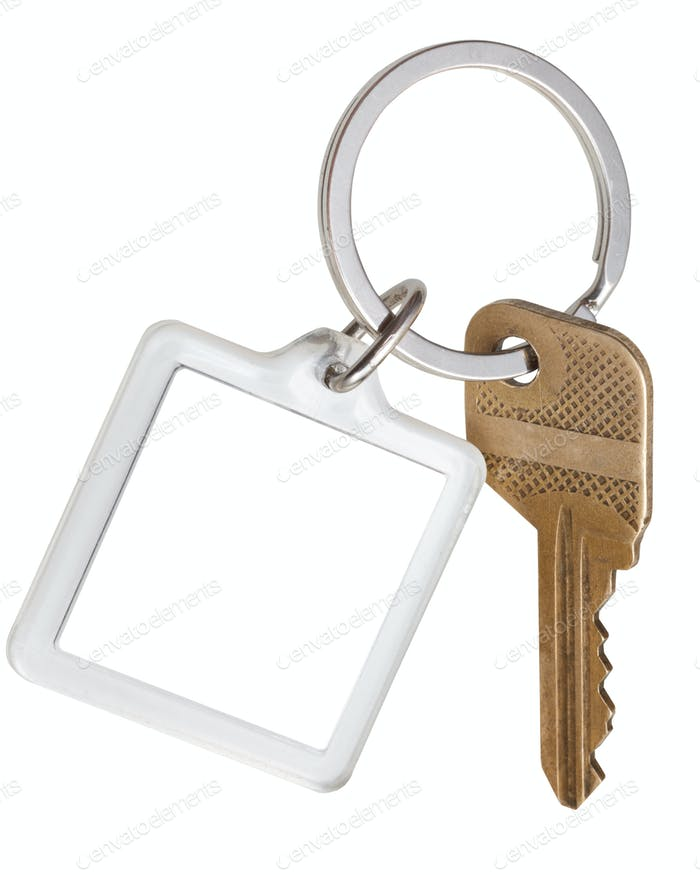 house brass key and square keychain on ring