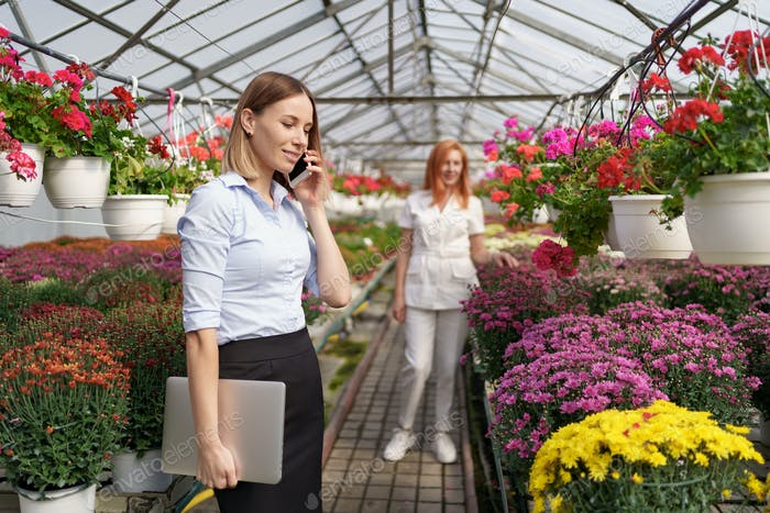 Woman talking on the phone discussing a business deal