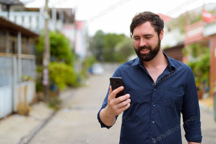 Handsome bearded businessman in the streets outdoors