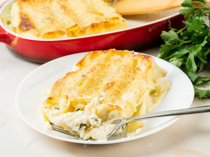 Cannelloni with filling of ricotta and parsley, baked with béchamel sauce