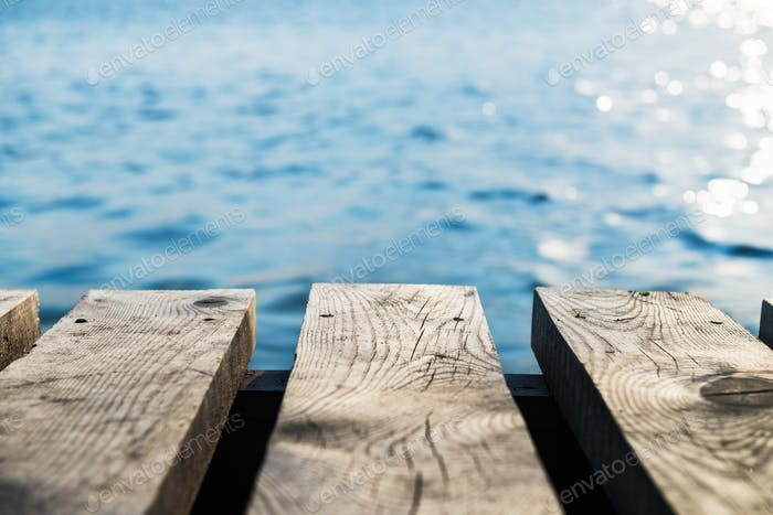 Old Wooden Pier with Blurred  Sea on the Background