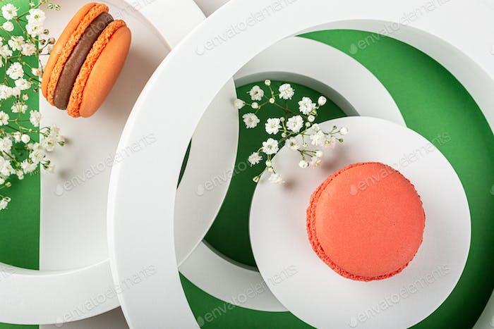 Cake macaron or macaroon on green background