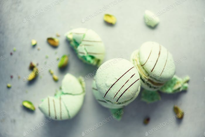 Green mint french macaroons with pistachios. Pastel colors macarons, copy space. Holidays and