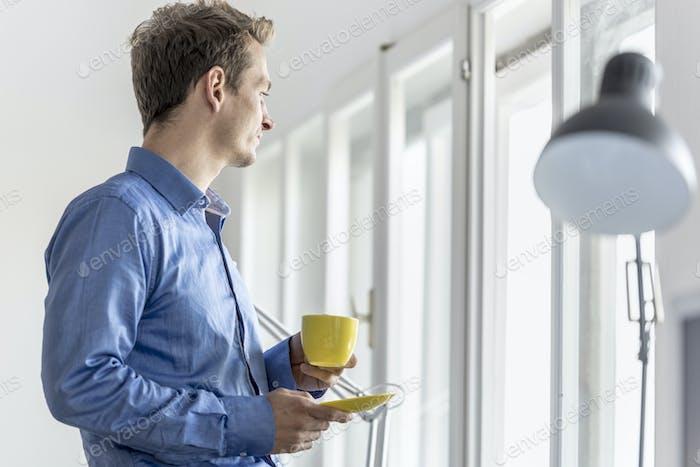 Businessman enjoying a cup of coffee