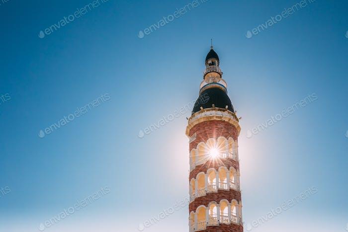 Batumi, Adjara, Georgia. Sun Shining Through Old Tower On Blue S