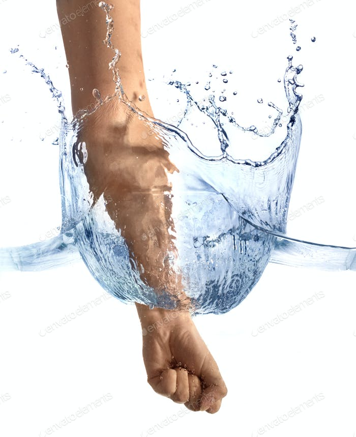 Fist hitting surface of the water.