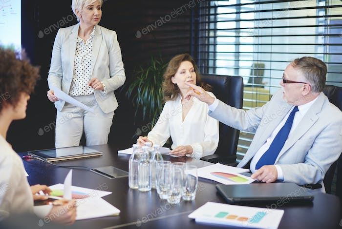 Business people comparing statistics together