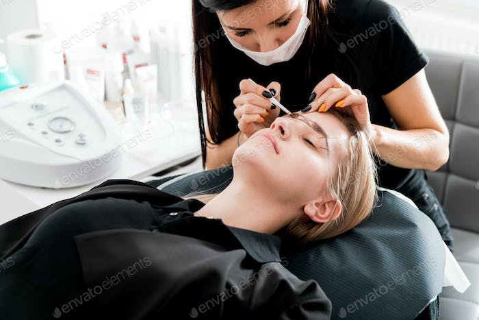 Permanent make up on eyebrows at beauty salon