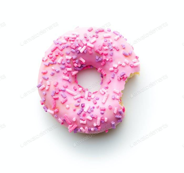 Pink bitten donut.