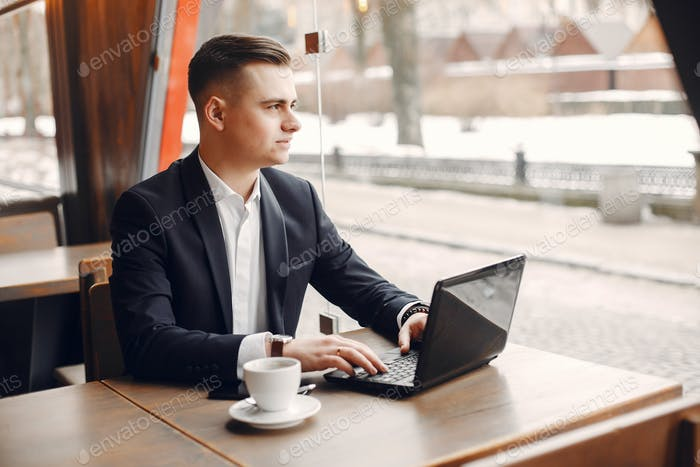 Businessman working in a cafe