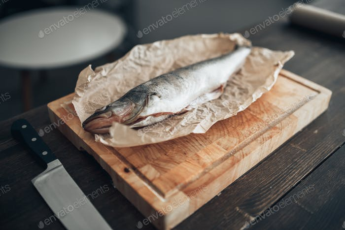 Fresh fish preparation on cutting board, closeup