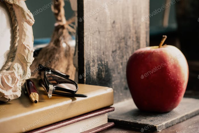 stationery and apple on desk