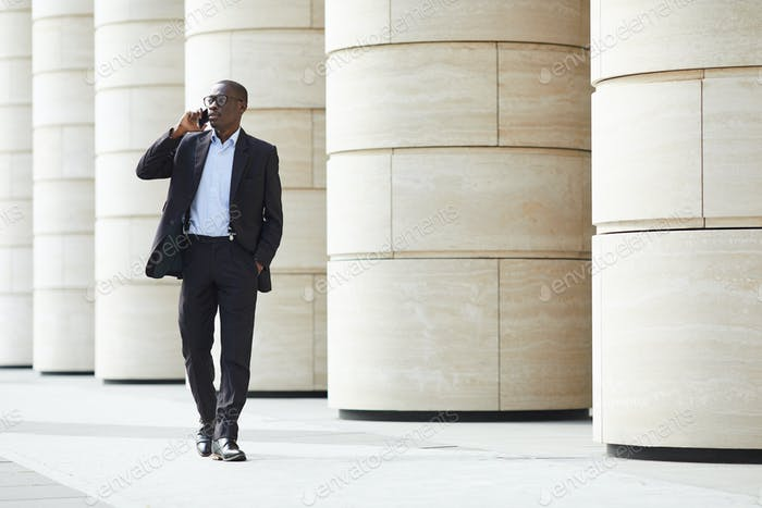 African-American Businessman walking in City