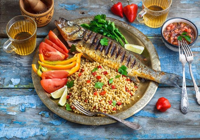 Grilled sea bass on coper plate, middle eastern style