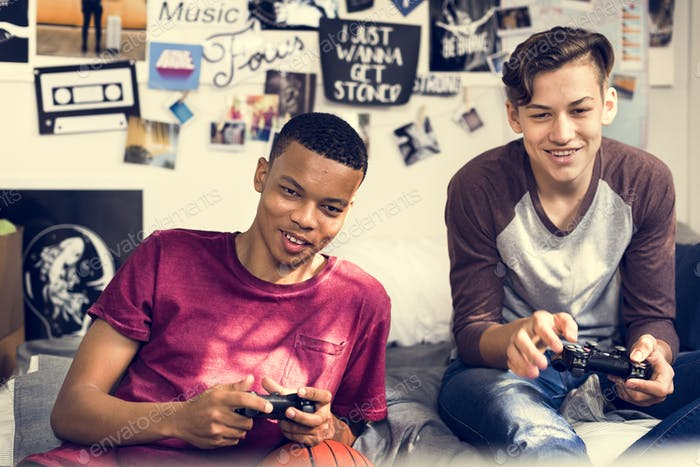 Thumbnail for Teenage boys hanging out in a bedroom playing video games together