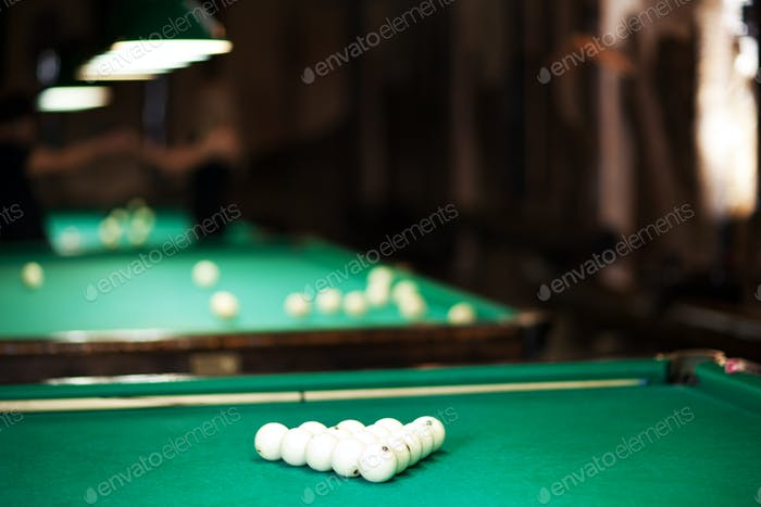 Table with green cloth and balls for billiards