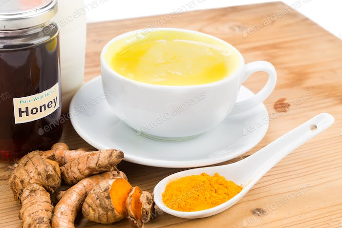Turmeric roots with milk and honey drinks for beauty and health.