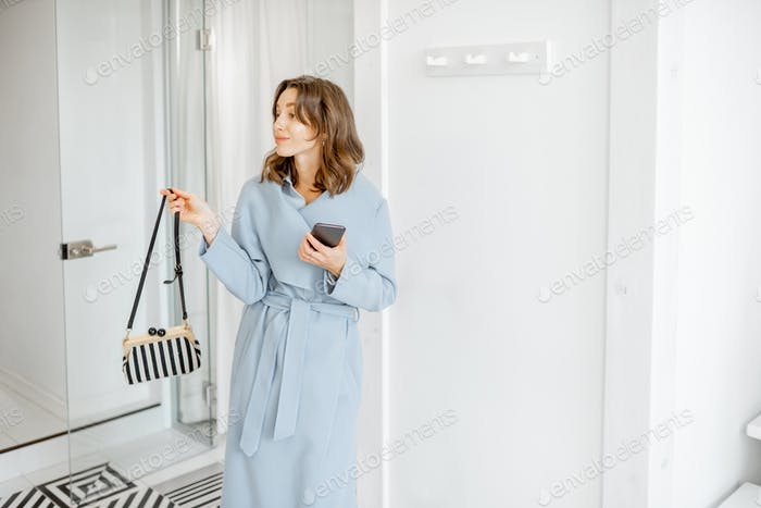 Woman getting ready to leave the apartment