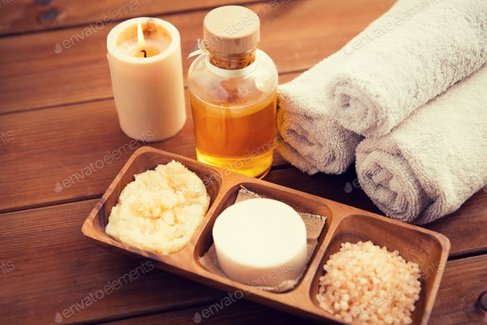 close up of natural cosmetics and bath towels