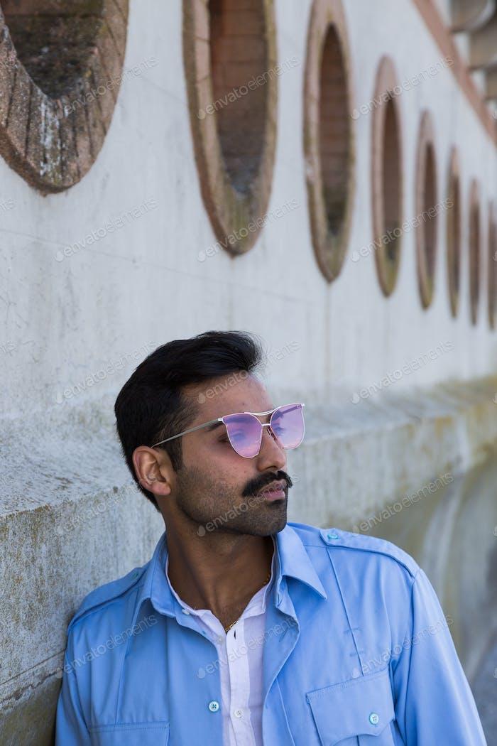 Handsome man posing in an urban context