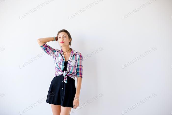 Determined model posing on white studio background