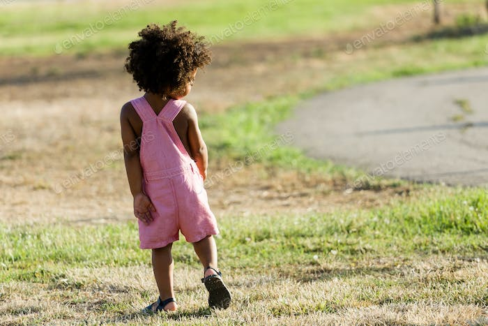 African american baby having fun in the park.