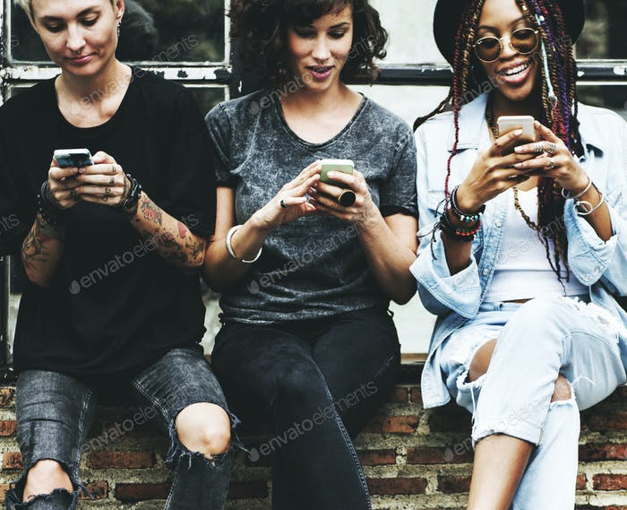 Women Use Mobile Phone Together