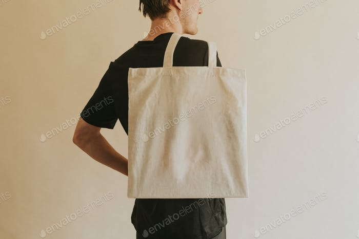 Back view man carrying tote bag