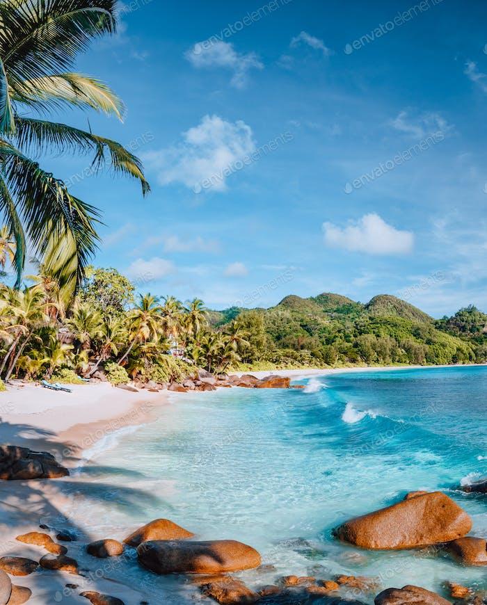 Mahe, Seychelles. Beautiful Anse intendance beach. Calm ocean waves rolling towards the shore with