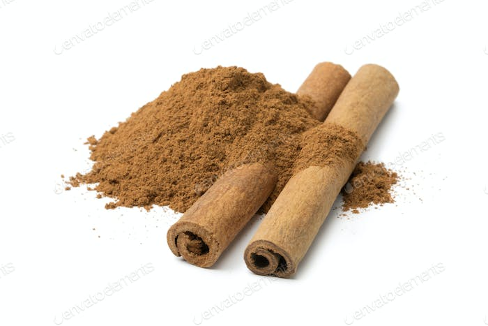 Heap of ground cinnamon and cassia cinnamon sticks